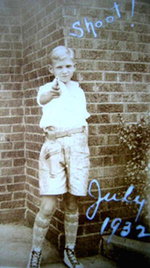 My Dad in 1932 - 10 Yrs. old with his six shooter