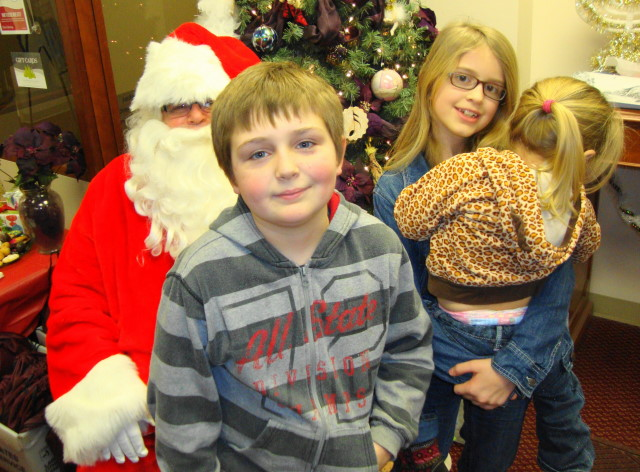 It took alot to get a 12 yr. old to pose with Santa! lol