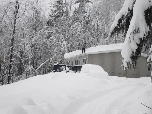 Hubby shoveling our kids roof - Their Jeep Buried!